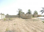 Partially built land for sale brufut b