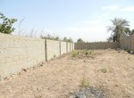 Partially built land for sale brufut c